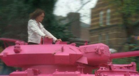 Alex Drake in a pink tank