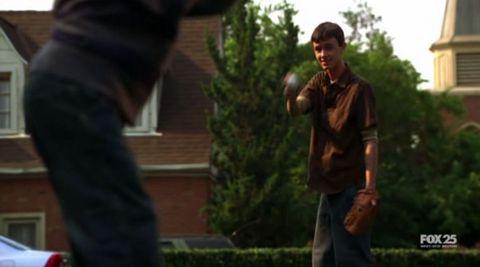 Kyle and Derek playing baseball