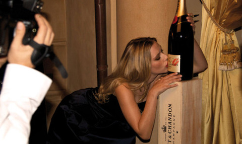 Scarlett Johansson kissing a champagne bottle