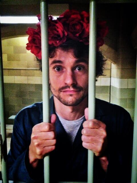 Hugh Dancy in a floral crown