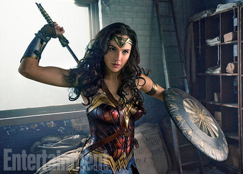 Gal Gadot as Wonder Woman with sword and shield